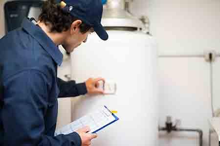 water heater repair by johns plumbing.